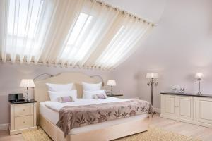 A bed or beds in a room at Villa by RODINA Grand Hotel & SPA