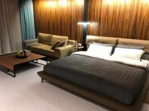 A bed or beds in a room at 555 House