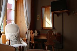 Coin salon dans l'établissement Auberge de l'Ange
