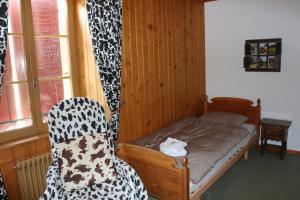 Un ou plusieurs lits dans un hébergement de l'établissement Auberge de l'Ange