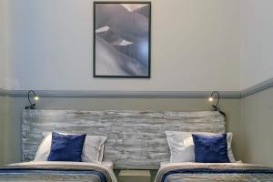 Cama o camas de una habitación en La AKDmia Cuba