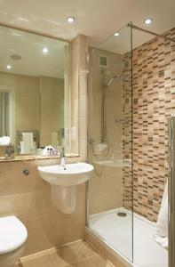 A bathroom at Macdonald Frimley Hall Hotel & Spa