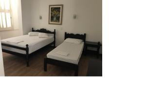 Cama o camas de una habitación en Farol Hotel
