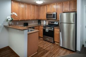 A kitchen or kitchenette at Tahiti All-Suite Resort