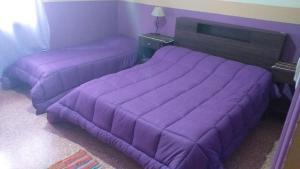 Una cama o camas en una habitación de La Covacha Hostel