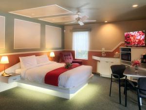 Un ou plusieurs lits dans un hébergement de l'établissement Motel La Cheminée