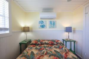 A bed or beds in a room at Blue Dolphin Inn and Cottages