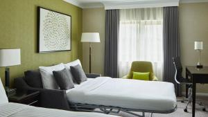 A bed or beds in a room at Manchester Airport Marriott Hotel