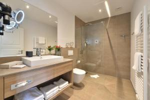 Ein Badezimmer in der Unterkunft Kurhotel Drei Birken