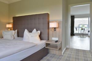 Ein Bett oder Betten in einem Zimmer der Unterkunft Kurhotel Drei Birken