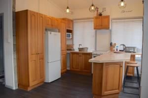 A kitchen or kitchenette at Wamberal Beach Escape