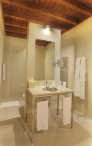 A bathroom at La Fiermontina - luxury home hotel