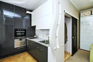 Кухня или мини-кухня в Елисеефф Арбат Отель