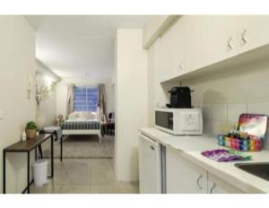 A kitchen or kitchenette at Super Convenient Studio Located in Melbourne CBD