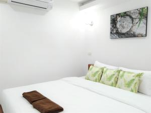 A bed or beds in a room at WEE HOSTEL