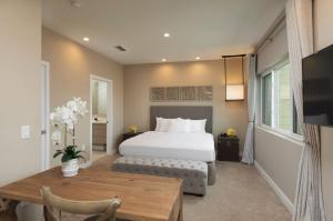 A bed or beds in a room at Magic Village Views Trademark Collection by Wyndham
