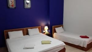 A bed or beds in a room at Jordan River Hotel