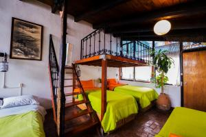 A bunk bed or bunk beds in a room at Hostel Mexico DF Airport