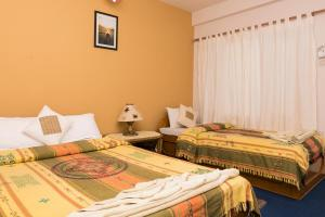 A bed or beds in a room at Peace Eye Guest House