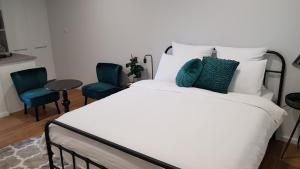 A bed or beds in a room at At Home Apartments