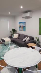 A seating area at At Home Apartments