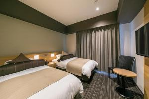 A bed or beds in a room at Hotel Miyahira