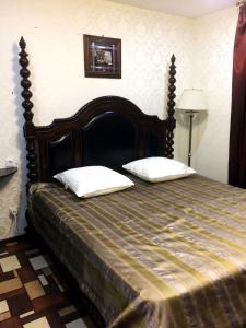 Кровать или кровати в номере Хостел Гости