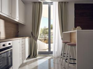 A kitchen or kitchenette at Arcs Boutique Villa Hotel