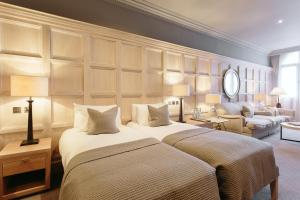 A bed or beds in a room at The Scotsman Hotel