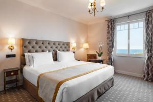 Cama o camas de una habitación en Eurostars Hotel Real