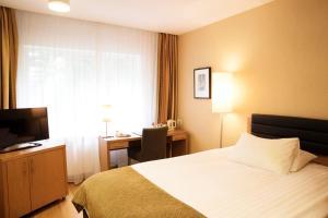 A bed or beds in a room at Hotel Reykjavík Centrum