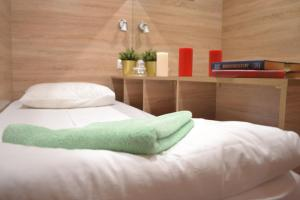 A bed or beds in a room at Box Hotel Valiano