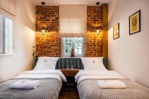 Кровать или кровати в номере Gotyk House