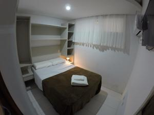 A bed or beds in a room at Hotel do Centro