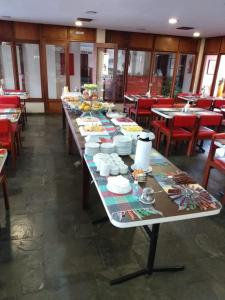 A restaurant or other place to eat at Angatu Hotel