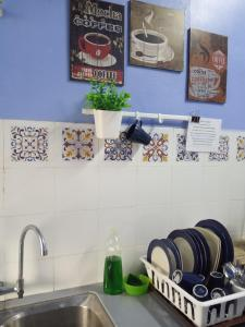 A kitchen or kitchenette at Homestay Tidurzzz Bandar Melaka