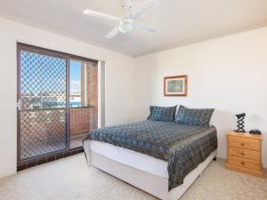 A bed or beds in a room at Seabreeze 3