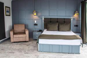 Letto o letti in una camera di Assos Kervansaray Hotel - Special Category