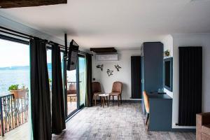 Area soggiorno di Assos Kervansaray Hotel - Special Category
