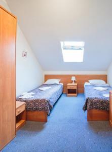 Кровать или кровати в номере Boyarskiy Dvor Hotel