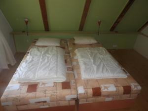A bed or beds in a room at Country House Lesik