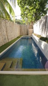 The swimming pool at or near Treetop Suites