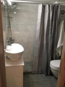 A bathroom at Renovated apartment, 1' to metro st. Panormou