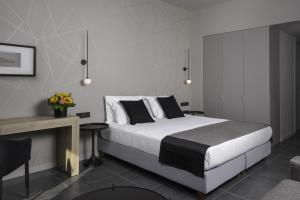 A bed or beds in a room at Azur Suites