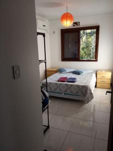 A bed or beds in a room at Residencial Joan