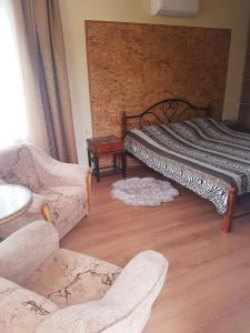 Кровать или кровати в номере Милана Гостевой Дом