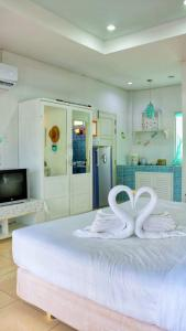 A bed or beds in a room at Prathana Garden Beach Resort