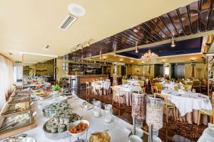 Een restaurant of ander eetgelegenheid bij Best Western Vilnius