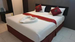 A bed or beds in a room at Fasai House by Paradee