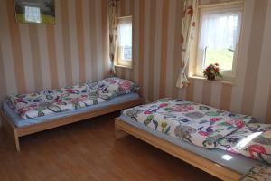Ein Bett oder Betten in einem Zimmer der Unterkunft Pension Gottesgrün
